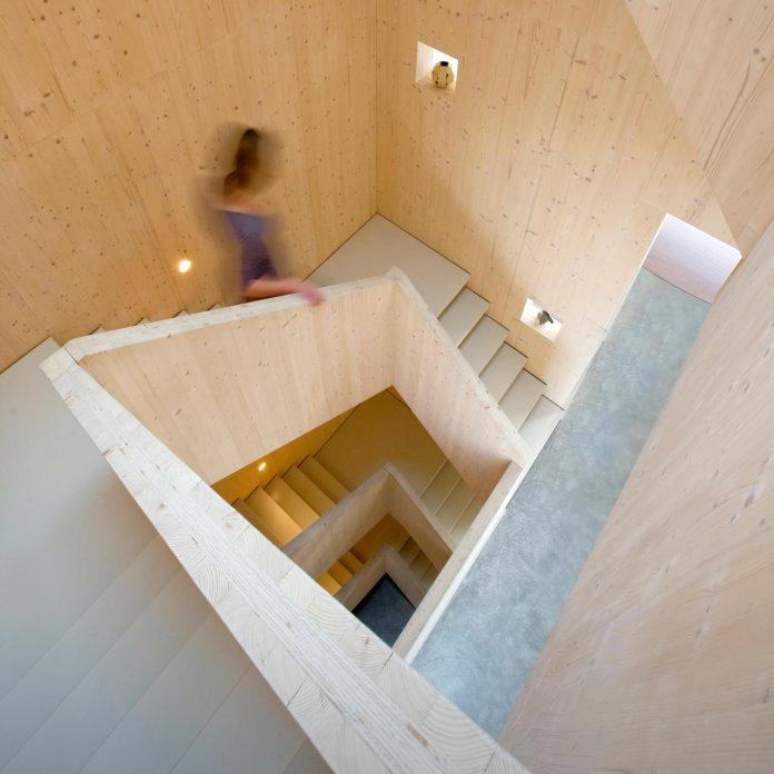 five-storey-wood-carving-home-built-prefab-wood-elements-07