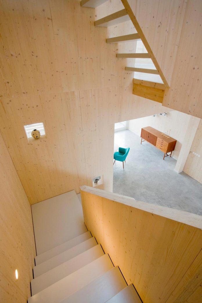 five-storey-wood-carving-home-built-prefab-wood-elements-09