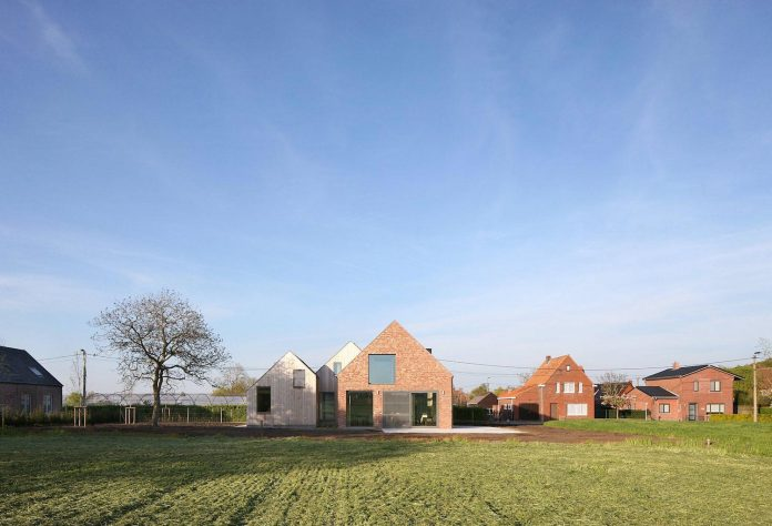 former-farmhouse-conversion-contemporary-pitched-roof-house-two-chimney-shaped-skylights-01