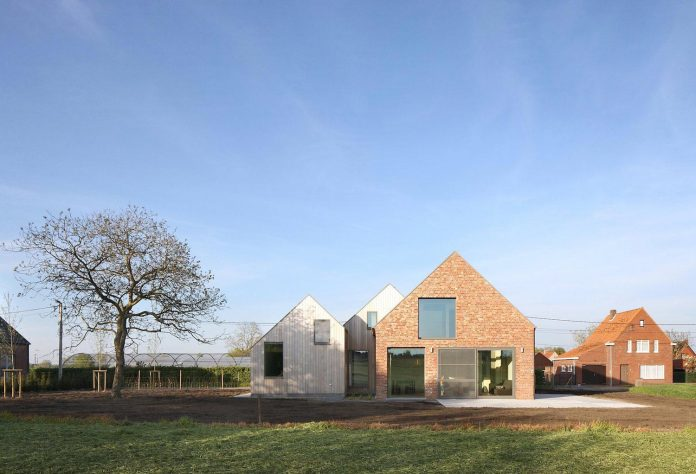 former-farmhouse-conversion-contemporary-pitched-roof-house-two-chimney-shaped-skylights-02