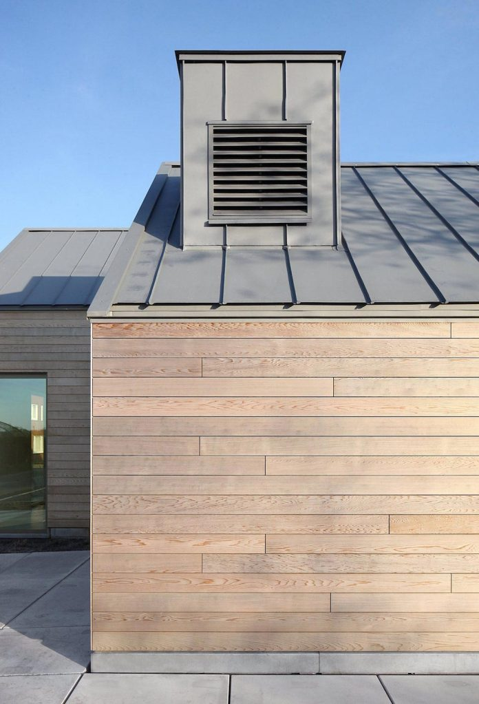 former-farmhouse-conversion-contemporary-pitched-roof-house-two-chimney-shaped-skylights-03