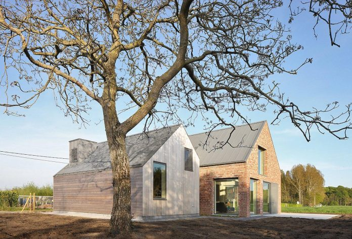 former-farmhouse-conversion-contemporary-pitched-roof-house-two-chimney-shaped-skylights-04