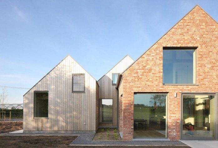 former-farmhouse-conversion-contemporary-pitched-roof-house-two-chimney-shaped-skylights-05