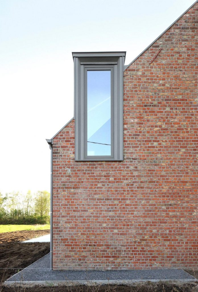 former-farmhouse-conversion-contemporary-pitched-roof-house-two-chimney-shaped-skylights-08