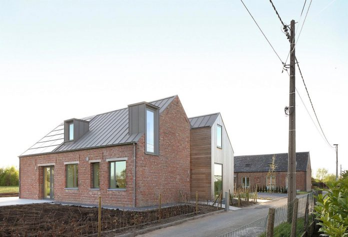 former-farmhouse-conversion-contemporary-pitched-roof-house-two-chimney-shaped-skylights-09