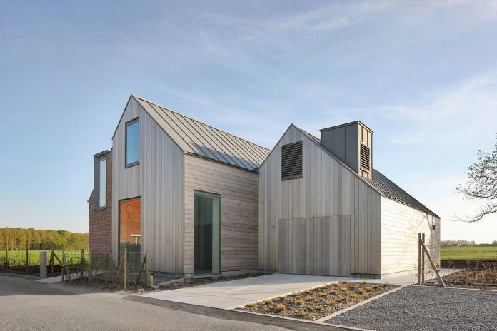 former-farmhouse-conversion-contemporary-pitched-roof-house-two-chimney-shaped-skylights-11