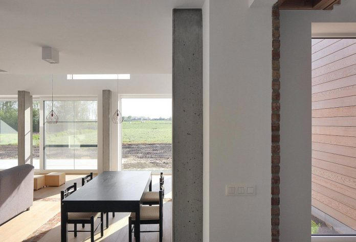 former-farmhouse-conversion-contemporary-pitched-roof-house-two-chimney-shaped-skylights-15