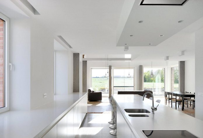 former-farmhouse-conversion-contemporary-pitched-roof-house-two-chimney-shaped-skylights-16