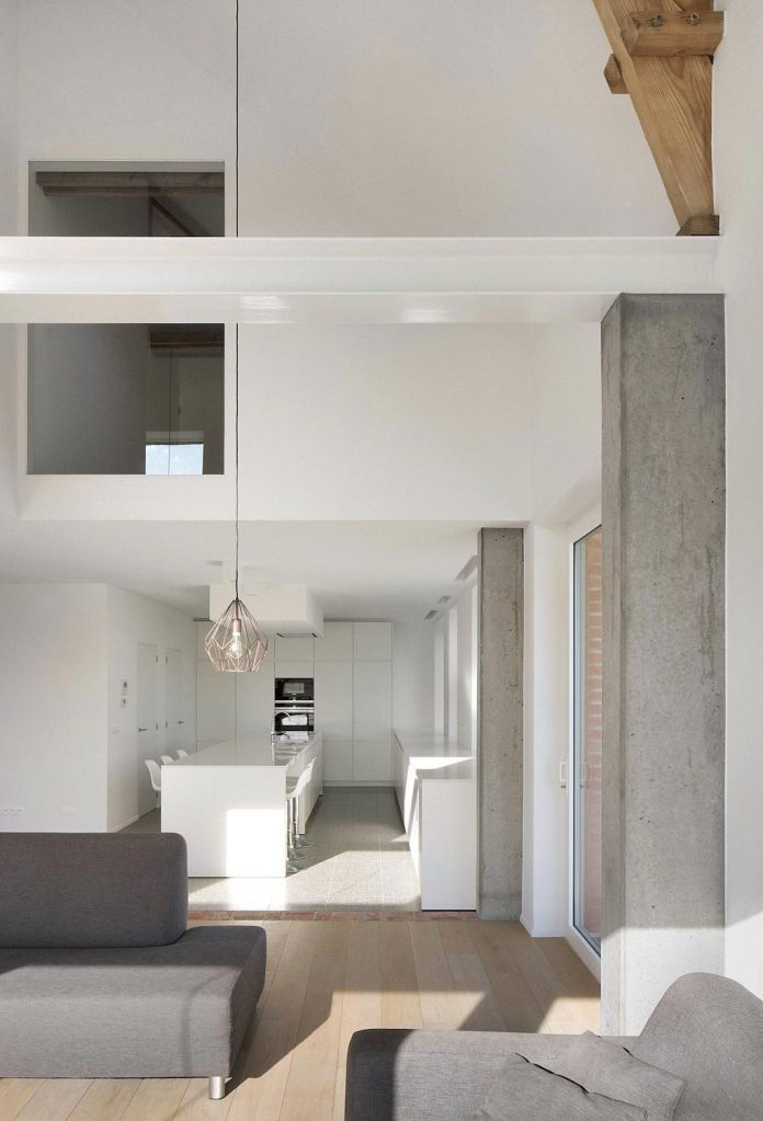 former-farmhouse-conversion-contemporary-pitched-roof-house-two-chimney-shaped-skylights-17