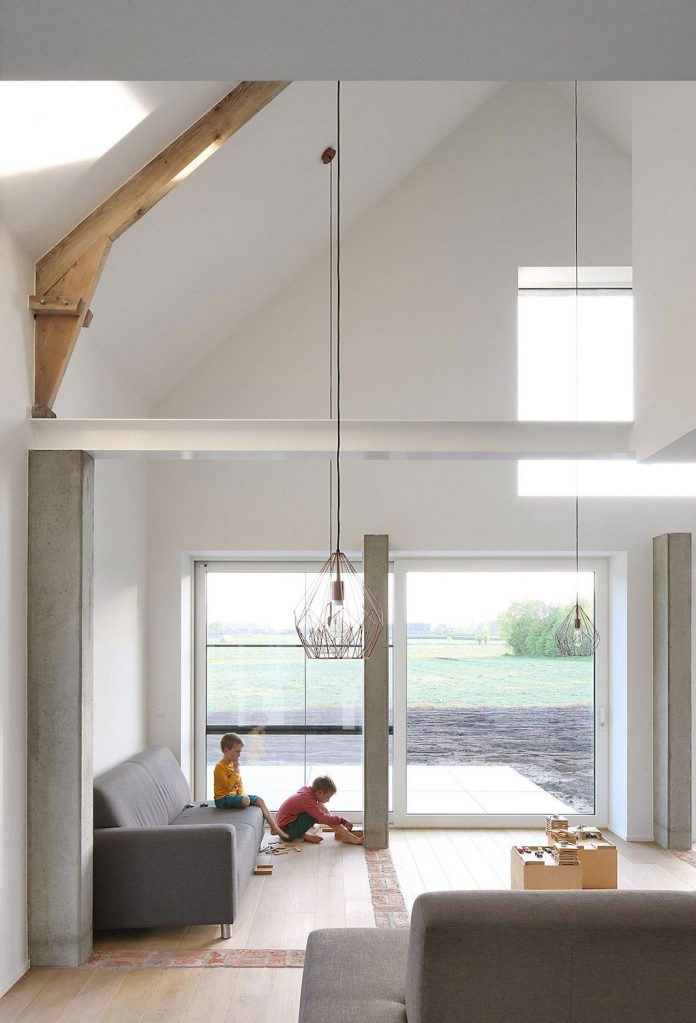 former-farmhouse-conversion-contemporary-pitched-roof-house-two-chimney-shaped-skylights-18