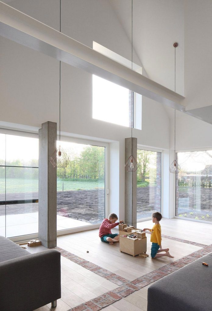 former-farmhouse-conversion-contemporary-pitched-roof-house-two-chimney-shaped-skylights-19
