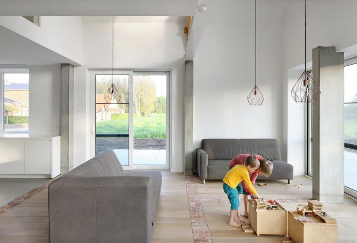 former-farmhouse-conversion-contemporary-pitched-roof-house-two-chimney-shaped-skylights-21