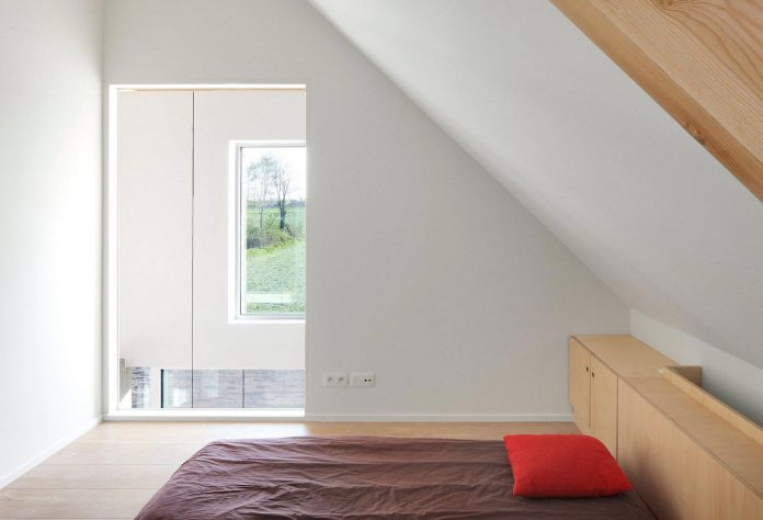 former-farmhouse-conversion-contemporary-pitched-roof-house-two-chimney-shaped-skylights-25