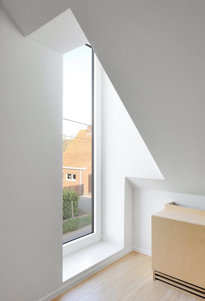 former-farmhouse-conversion-contemporary-pitched-roof-house-two-chimney-shaped-skylights-26