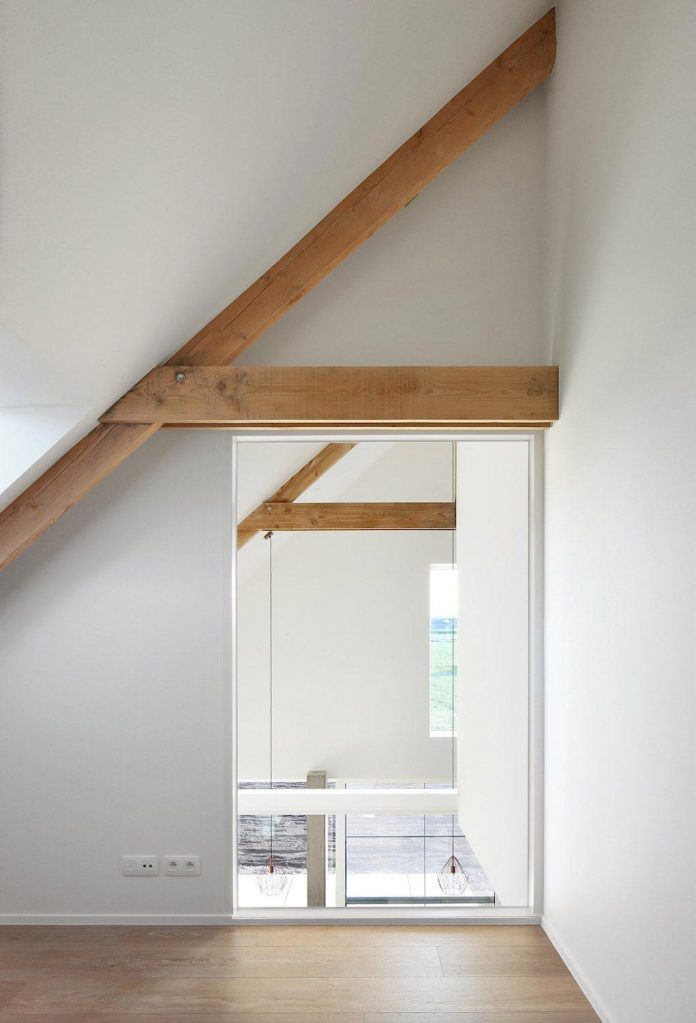 former-farmhouse-conversion-contemporary-pitched-roof-house-two-chimney-shaped-skylights-27