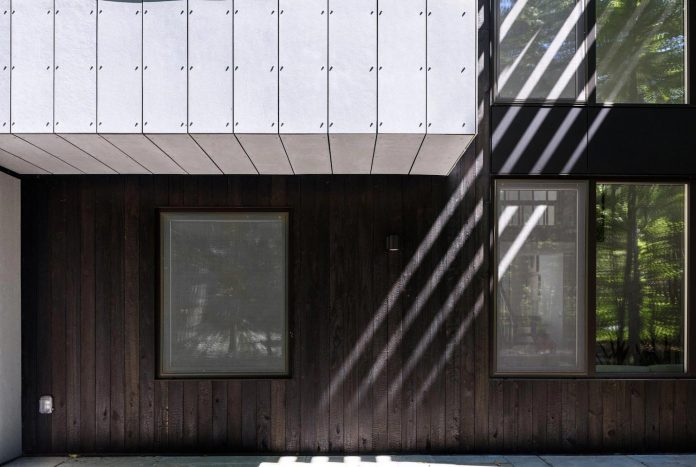 Home Renovation Covered In Fiber Cement Paneling And Shou