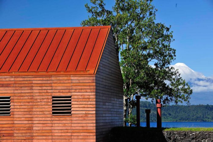 maiten-holiday-residence-situated-shores-llanquihue-lake-featuring-wooden-facades-red-metal-roofs-10
