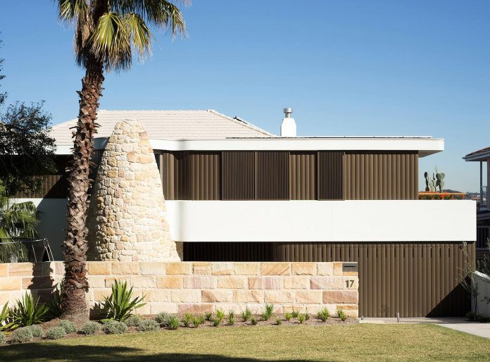 martello-tower-home-3-storey-brick-house-built-early-60s-gets-contemporary-additions-01