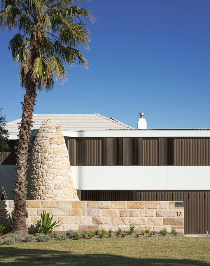 martello-tower-home-3-storey-brick-house-built-early-60s-gets-contemporary-additions-02