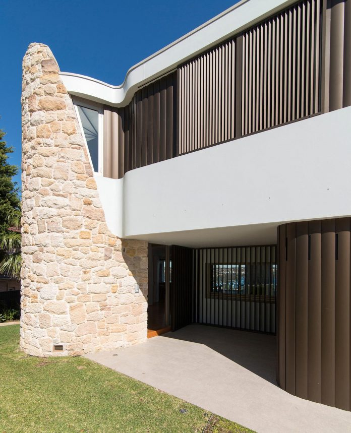 martello-tower-home-3-storey-brick-house-built-early-60s-gets-contemporary-additions-04