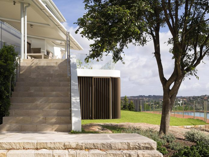 martello-tower-home-3-storey-brick-house-built-early-60s-gets-contemporary-additions-05