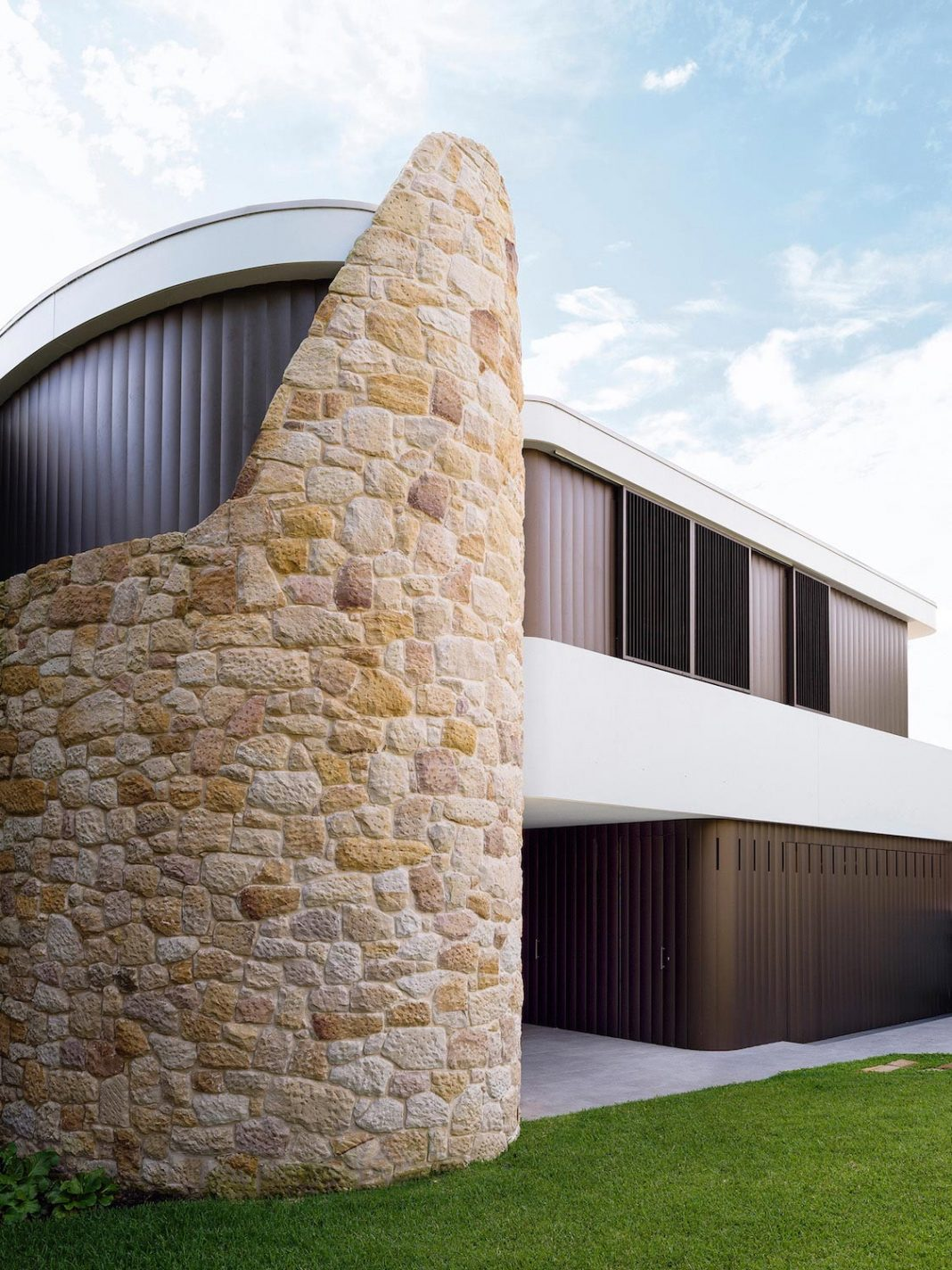 Martello Tower Home: the 3 storey brick house built in the early 60s gets contemporary additions