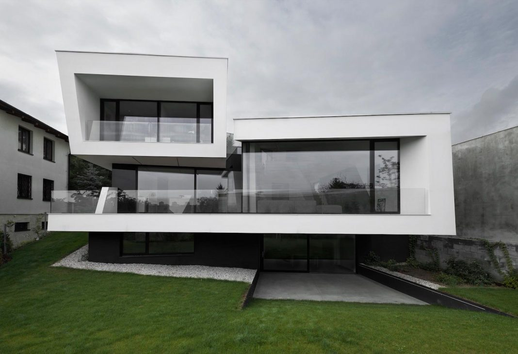 Minimalist home design located on a south sloping plot in for Home building architecture