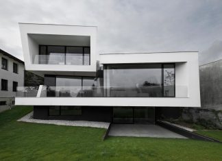 Minimalist home design located on a south sloping plot in a residential part of Prague