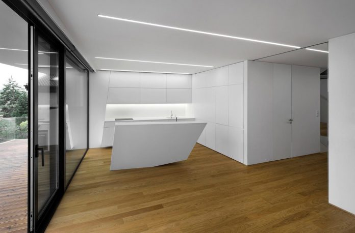 minimalist-home-design-located-south-sloping-plot-residential-part-prague-07