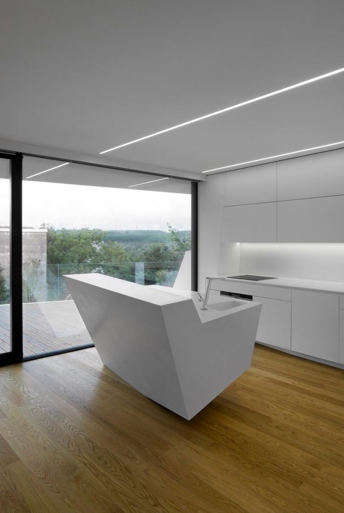 minimalist-home-design-located-south-sloping-plot-residential-part-prague-08
