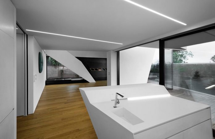 minimalist-home-design-located-south-sloping-plot-residential-part-prague-09