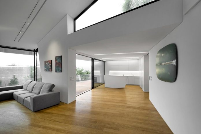 minimalist-home-design-located-south-sloping-plot-residential-part-prague-12