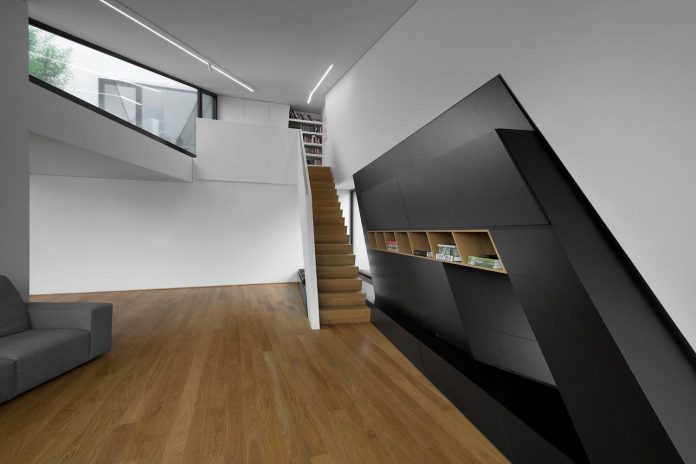 minimalist-home-design-located-south-sloping-plot-residential-part-prague-13