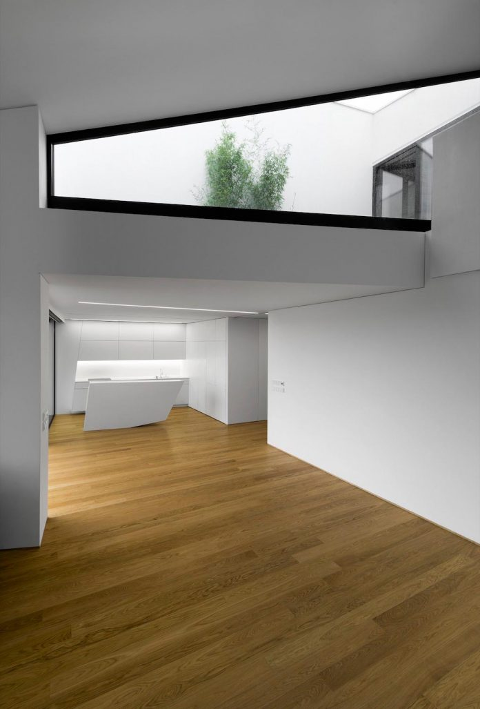 minimalist-home-design-located-south-sloping-plot-residential-part-prague-14