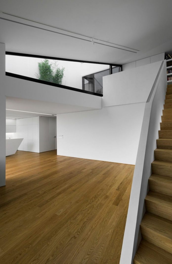 minimalist-home-design-located-south-sloping-plot-residential-part-prague-15