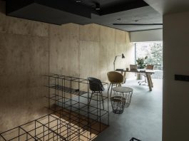 """Office designed with the idea of """"simplicity is beauty"""" uses wood, concrete and a bit of metal"""