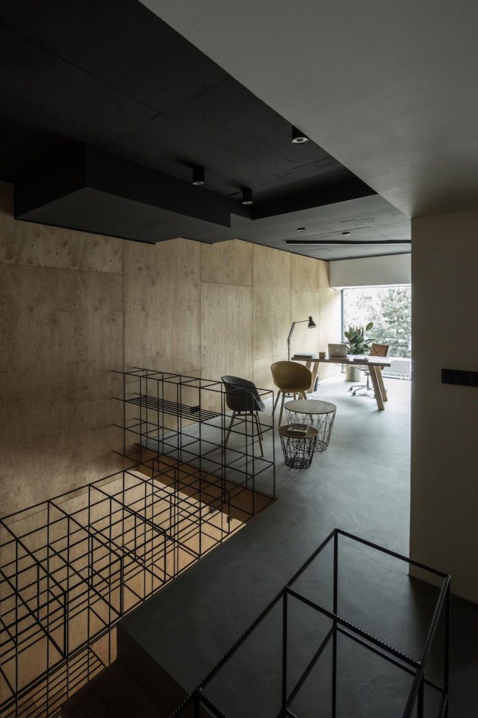 "Office designed with the idea of ""simplicity is beauty"" uses wood, concrete and a bit of metal"