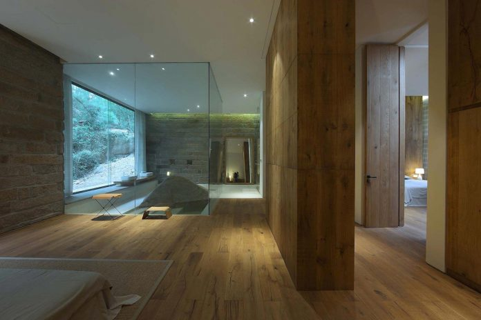 peaceful-home-located-wild-hillside-surrounded-mountains-forests-facing-sea-13