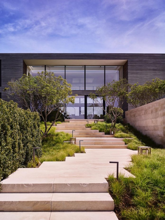 perched-ocean-pond-field-house-almost-appears-allow-landscape-run-01