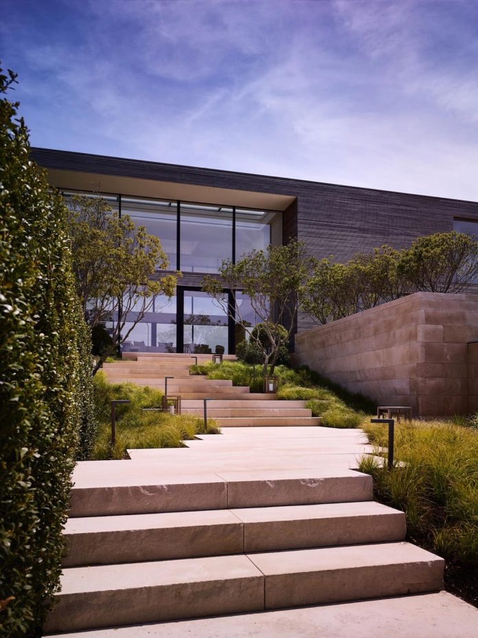 perched-ocean-pond-field-house-almost-appears-allow-landscape-run-02