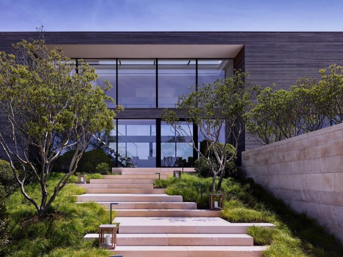 perched-ocean-pond-field-house-almost-appears-allow-landscape-run-03