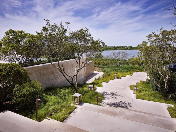 perched-ocean-pond-field-house-almost-appears-allow-landscape-run-04