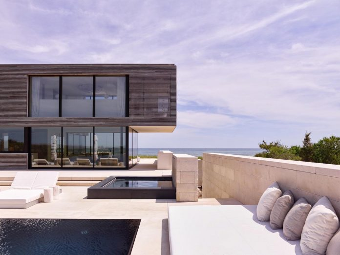 perched-ocean-pond-field-house-almost-appears-allow-landscape-run-05