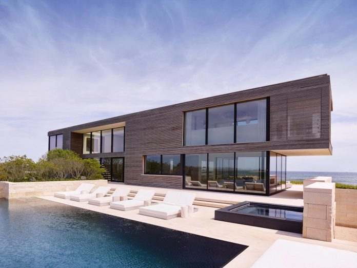 perched-ocean-pond-field-house-almost-appears-allow-landscape-run-06