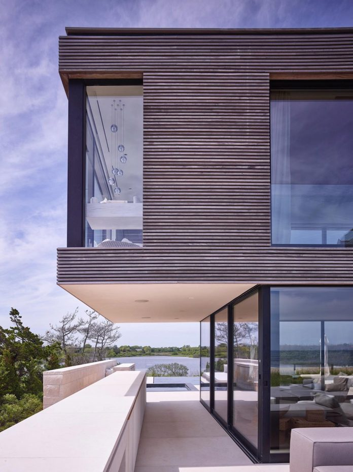 perched-ocean-pond-field-house-almost-appears-allow-landscape-run-07