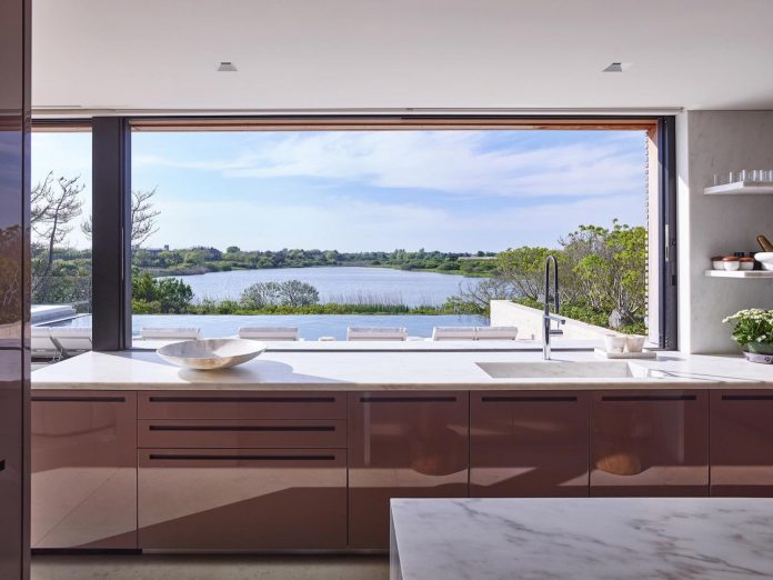 perched-ocean-pond-field-house-almost-appears-allow-landscape-run-09