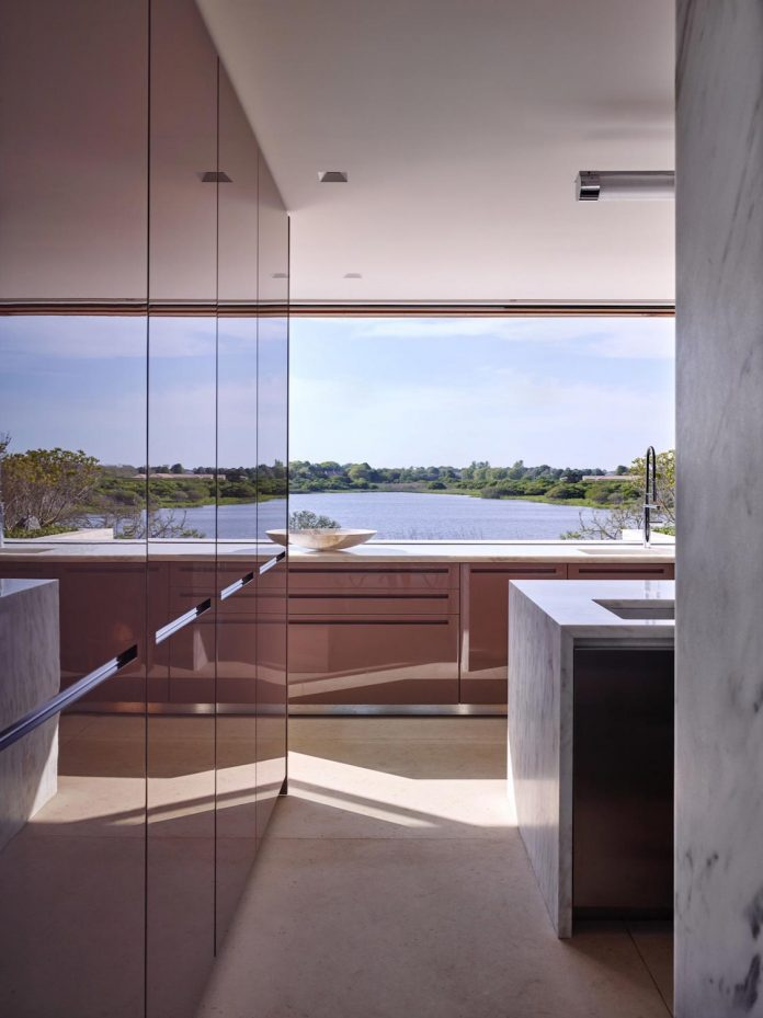 perched-ocean-pond-field-house-almost-appears-allow-landscape-run-10