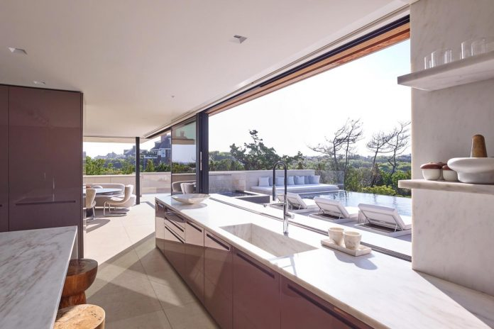 perched-ocean-pond-field-house-almost-appears-allow-landscape-run-12