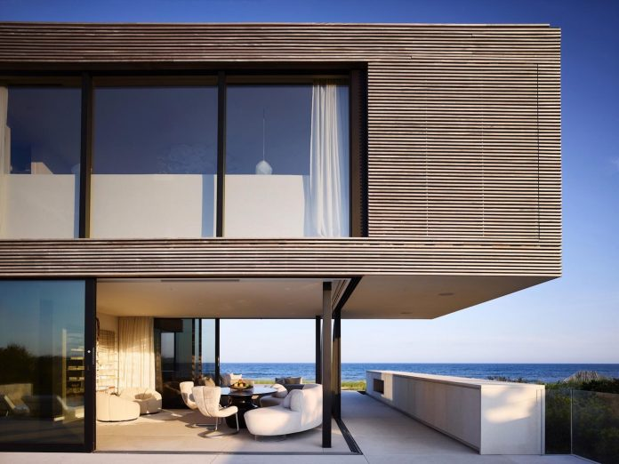 perched-ocean-pond-field-house-almost-appears-allow-landscape-run-14