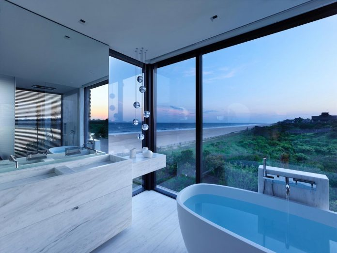 perched-ocean-pond-field-house-almost-appears-allow-landscape-run-20